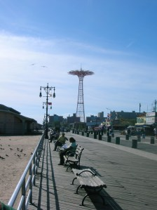 "Coney Island Boardwalk with the now defunct Parachute Jump ride in the distance, once called ""Brooklyn's Eiffel Tower"" by Wikipedia"